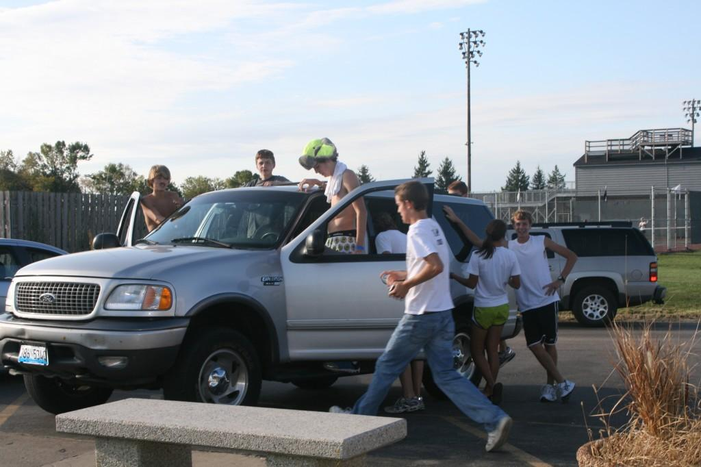 After cross country practice, junior Frankie Furco ( in the driver's seat) takes friends home. Due to budget cuts, carpooling is common with students.