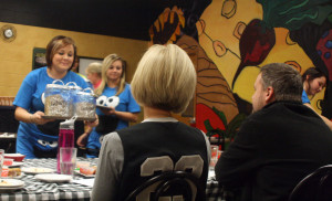 Contestants present the monster cookie to judges Michelle Jurcenko and Patrick Trapp. Photo by Tyler Keenum.