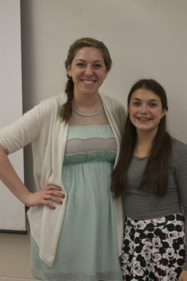 English teacher Christina Staker poses with an appreciative student.