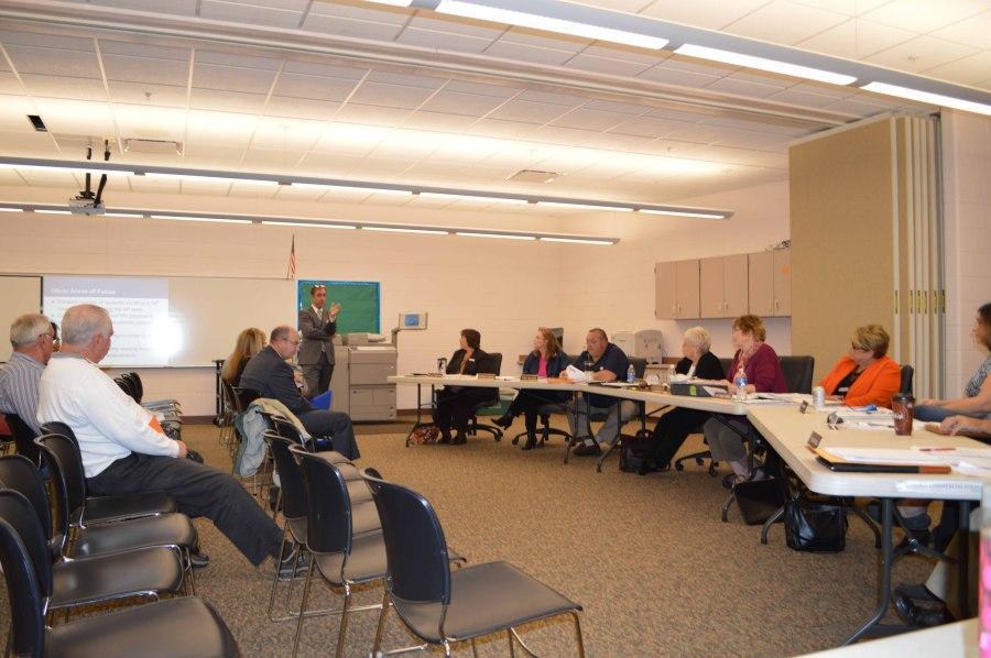 Board+members+discuss+the+2014-2015+School+Improvement+Plan.+Photo+by+Ava+Mandele