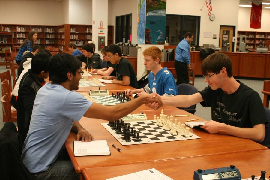 Kaneland students on the chess team compete in the library.
