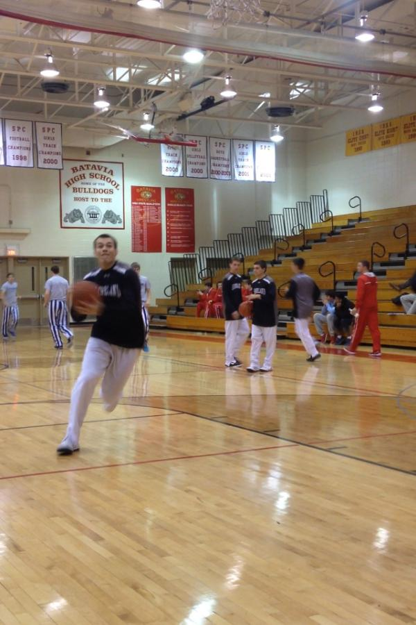 Jake Gomes cuts into the lane during Kanelands pregame warmups at Ken Peddy Windmill Classic.