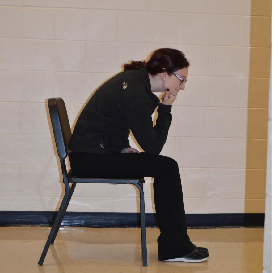 Senior Elise Fichtel slouches to demonstrate bad posture.