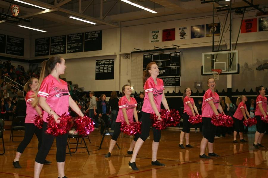 The Pom team performs at the start of the assembly, occurring on February 13.