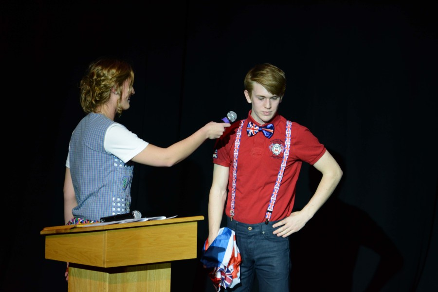 Contestant James Tockstein answers questions asked by M.C. Ally VanBogaert.