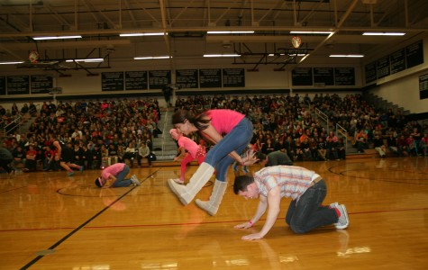 Kaneland staff members enjoy a game in the East Gym during the winter assembly.