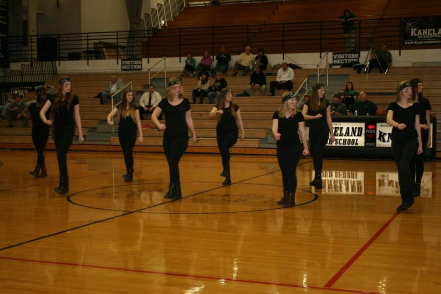 The Poms team performs a new military-style dance routine.