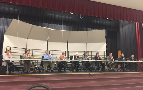 Board members discuss teacher contracts.