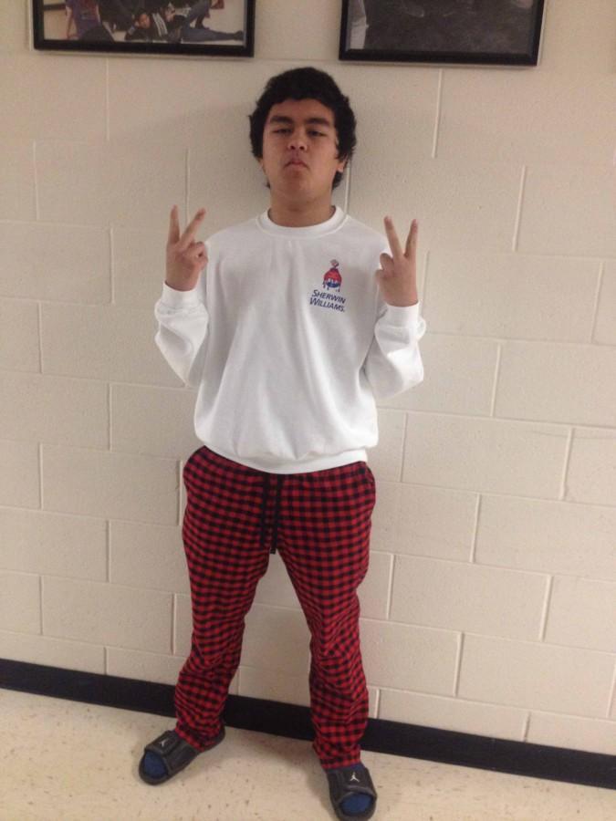 Junior Derek Pulliam shows off his spirit by wearing plaid pajama bottoms.