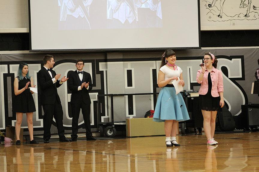 Seniors+Aimee+Frost+and+Julia+Lemp+present+Nora+Tomasik+with+a+check+from+the+Kaneland+Cares+Fund+at+the+Winter+assembly.+