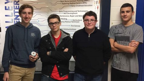 """This incredible group of four, Carson Doll, Michael Hammond, Nathan Ord, and Tony Golbeck are the creators of the """"Better Weather Buddy"""". The group of four went to an event called the Huskie Hack where they had 24 hours to make and present their invention, """"Better Weather Buddy""""."""
