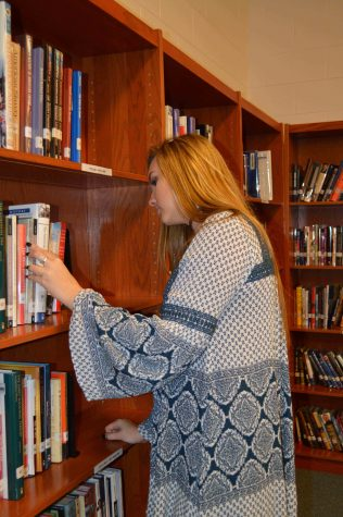 Senior Kylie Modaff is looking for the perfect book to read. Soon the library will have more books for students.