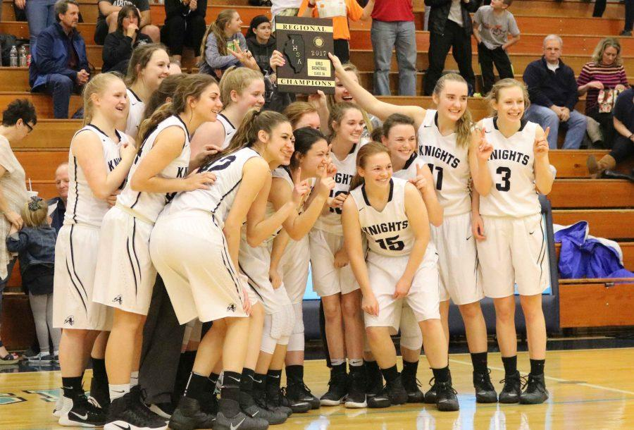The varsity girls are holding the championship plaque high. Proud t be Kaneland Knights.