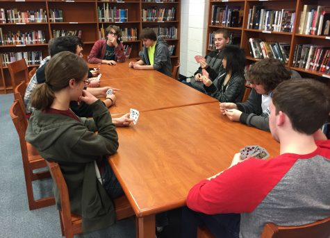 A part of the Sci-Fi Anime club enjoy a quick game of cards in their annual meet up on Thursday. The three visibly seen in the back corner are Isaac Martin, James Leyden and Josh Childress helped set the game up and come to about every meeting.