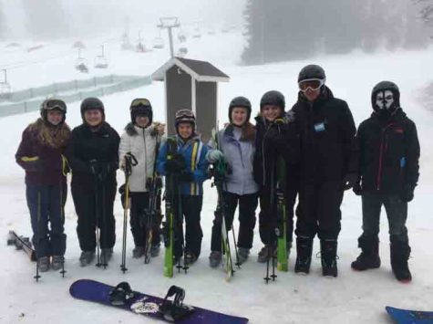 Emma Hockey, Julia Biard, Rachel Brazee, Andrea Wells, Katie Biard, Morgan Angelo, Joshua May and Brandon Albarron all prepare for ski school. The excitement came an hour and a half later when they took their skills to the slopes.