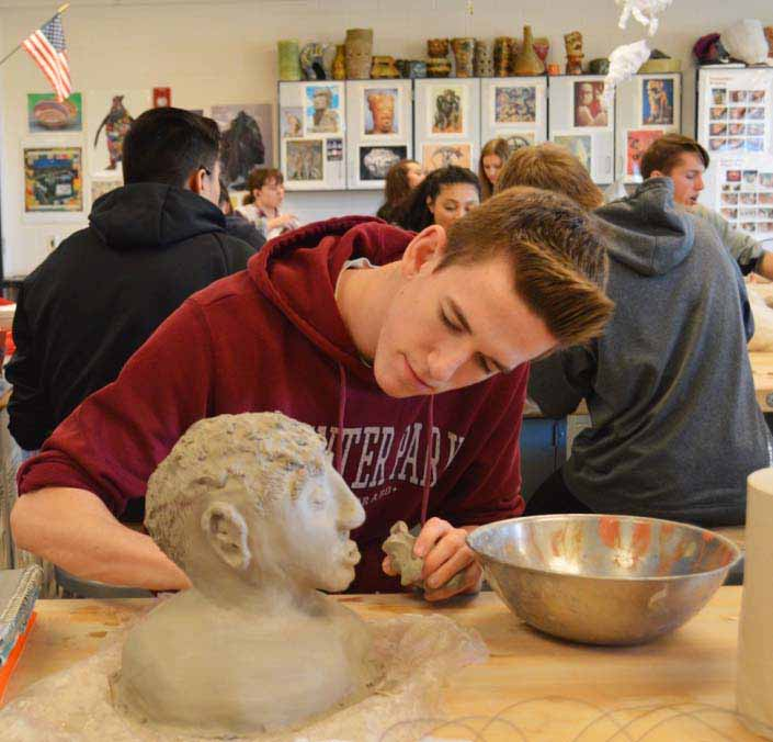 Choosing a different angle to work from, Trevor Cannon pays close attention to every new adjustment he makes to his clay sculpture. Selecting a new take on what to create, Cannon constructed an uncommon being that showcased his creativity.