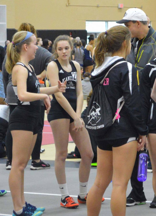 Coach+Andrew+Franklin+preps+the+girl+jumpers++during+warmups+at+the+Hononegah+Classic.+Long++jumpers+Amanda+Malawski+and+Linsey+Turner%2C++both+sophomores%2C+prepare+for+one+of+their+first+meets+of+the+season.