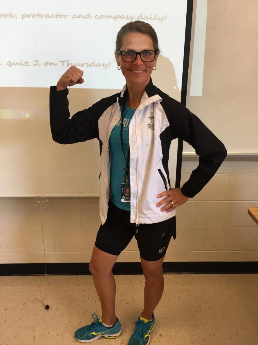 Math+teacher+Rebecca+Williams+shows+off+her+training+apparel+during+class.