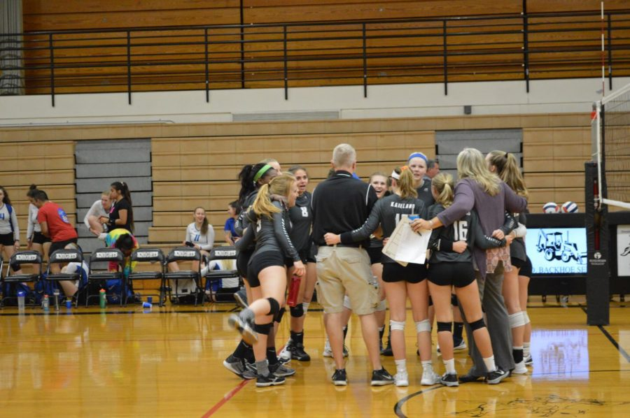 The+volleyball+team+celebrates+their+regional+victory+at+the+end+of+the+game.