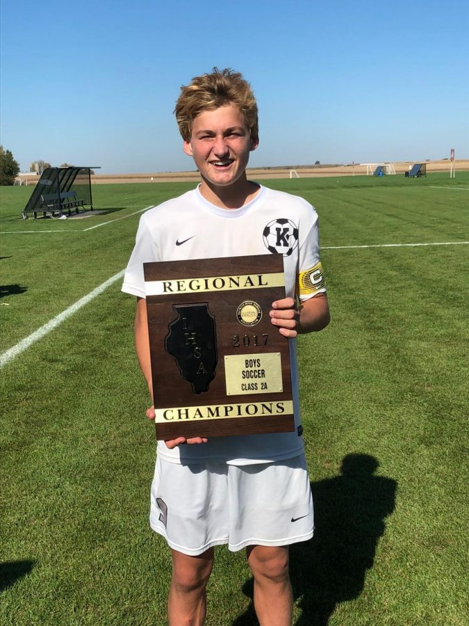 Bartholomew holds the regional champion plaque after their game went into penalty kicks. Photo courtesy of Dorcey Bartholomew.
