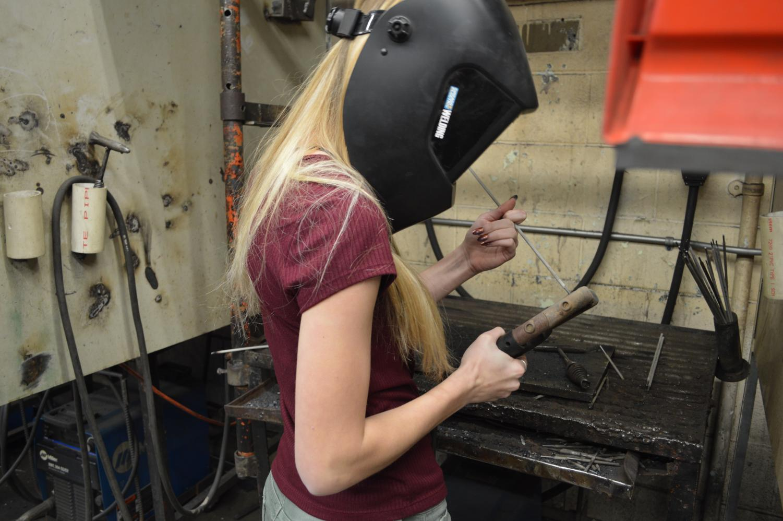 Junior Ashtyn Winkler prepares to weld.