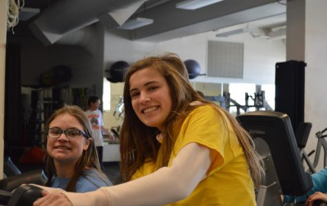 """All smiles from Ashley Hughes and Natalie Kraemer while they pedal away on the bikes talking about their day. """"I always push to go on the bikes because I enjoy working out but also being able to talk with Ashley and how she is doing."""" Kraemer said."""
