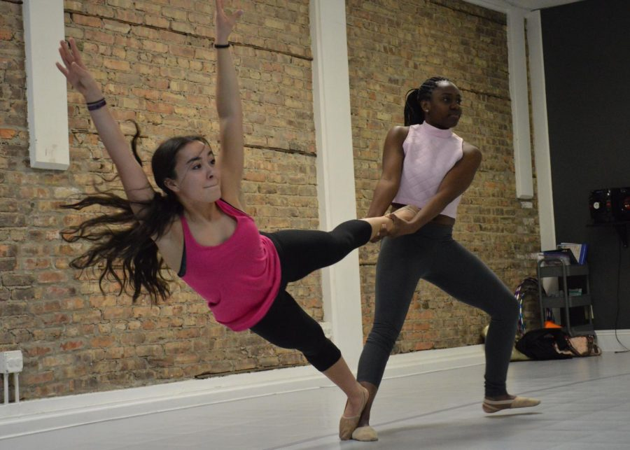 Working on a contemporary dance, Lynnea Njoya and Daylin Ayala practice a tricky move for an upcoming recital in June. Contemporary dance includes elements from different dance styles like jazz, lyrical, classic ballet and modern.