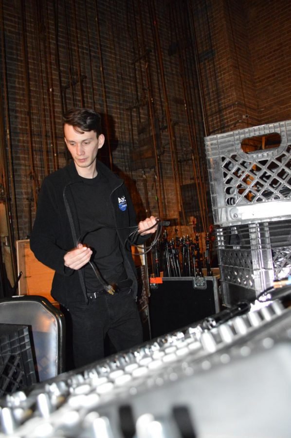 Lighting designer, Dominick Manzo, cleans up backstage at the Arcada Theatre in preparation for ABBA Mania's performance the next morning. Manzo worked by himself as he organized cables and equipment to clear space for the incoming act.