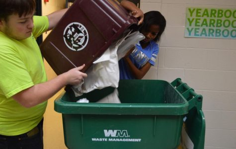 Sophomore Noah Treadway and Junior Nyalah Thomas help each other recycle.  These Brighter Future Club students help recycle every Thursday.