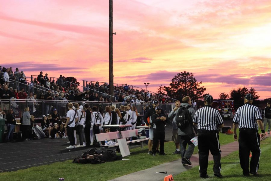 The+Homecoming+court%2C+including+king+Will+Marshall+and+queen+Peyton+Giffney%2C+are+announced+before+the+start+of+the+game.