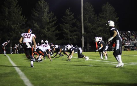 A DeKalb receiver starts in motion while the Kaneland defense awaits the snap.