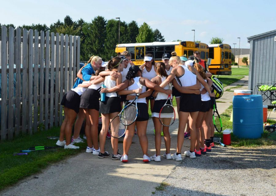 Near the courts, the girls get pumped up for their upcoming match against Geneseo.