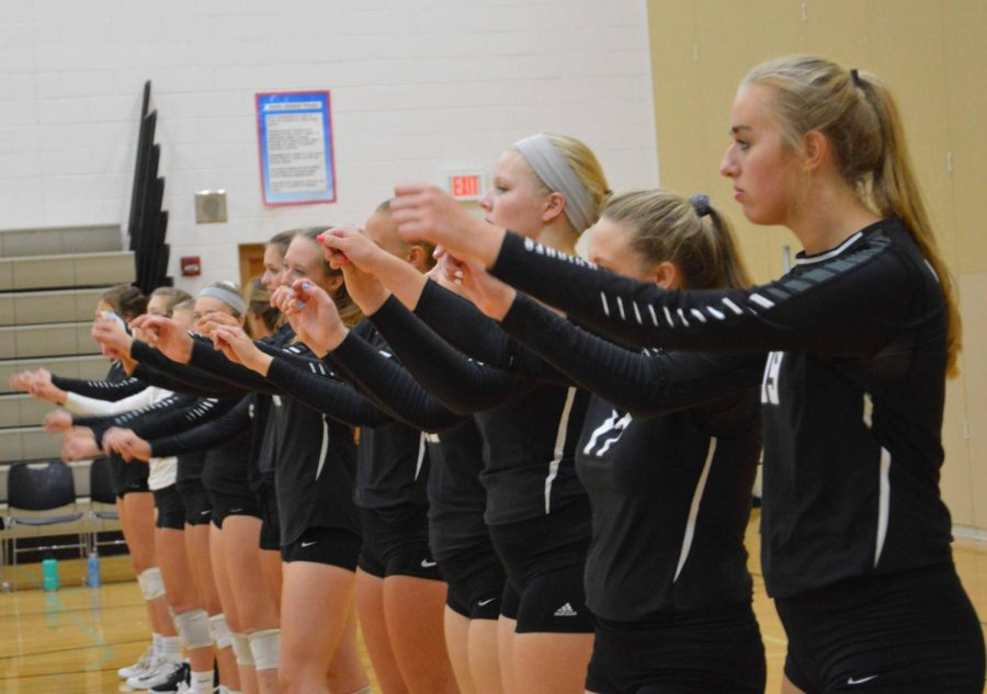 The+Kaneland+varsity+volleyball+team+lines+up+for+their+game.