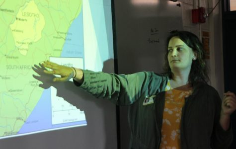 Graduate Katie Meuer teaches a class about where she lives in the country, Lesotho.