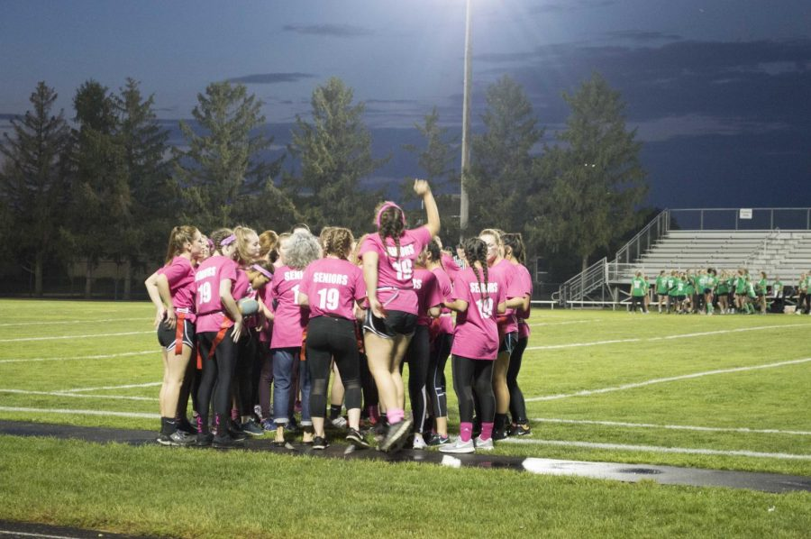 The seniors prepare to win their final Powderpuff game after a loss of 41-7 the previous year.