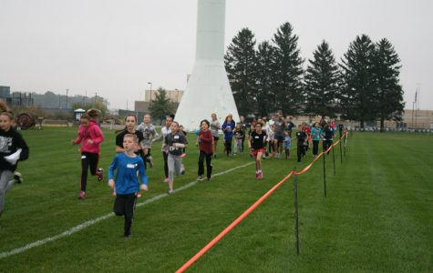 The Run for Your Life race begins. The runners race in packs so that they won't be attacked individually.