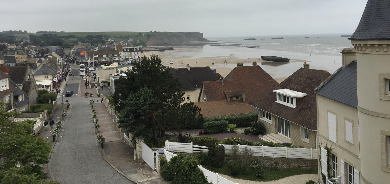 From+up+high%2C+the+town+looks+like+a+normal+coastal+place+to+visit+except+for+the+war+craft+still+stationed+along+the+beach.+Instead+of+disposing+the+historic+machines%2C+Arromanches+protects+the+history.