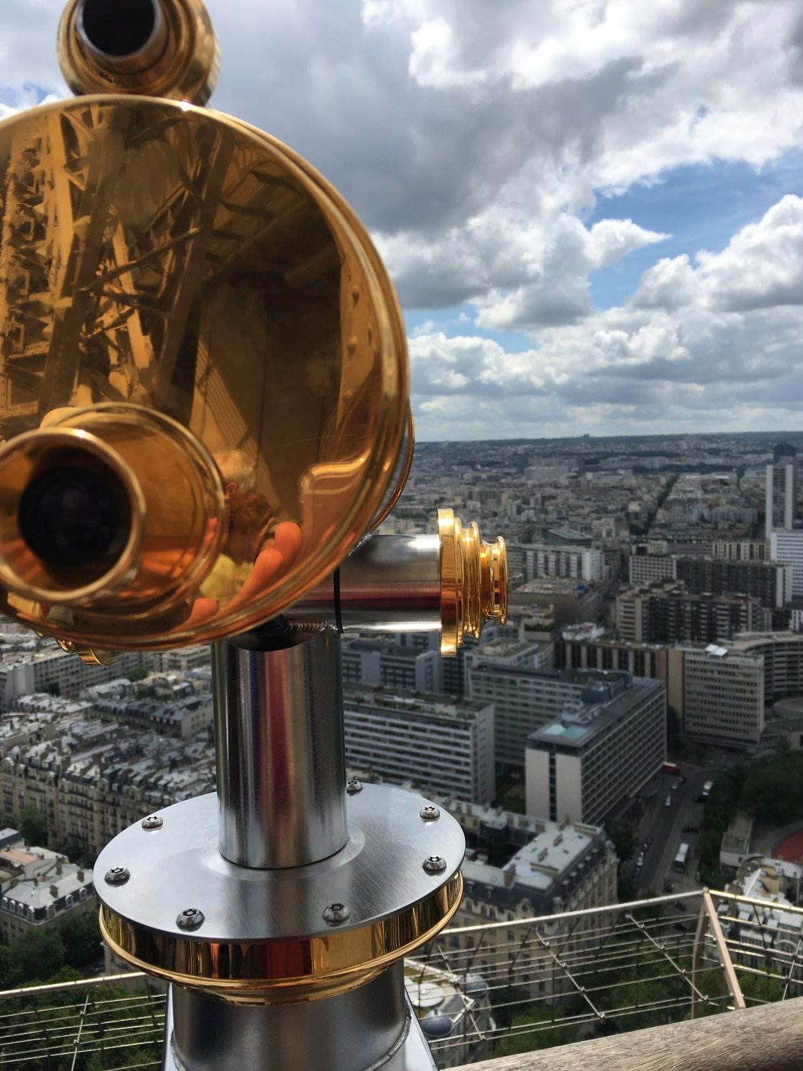 Using+the+telescopes+stationed+at+the+different+levels%2C+tourists+can+use+the+elevated+sightlines+to+get+a+closer+look+at+the+different+streets+of+Paris.+
