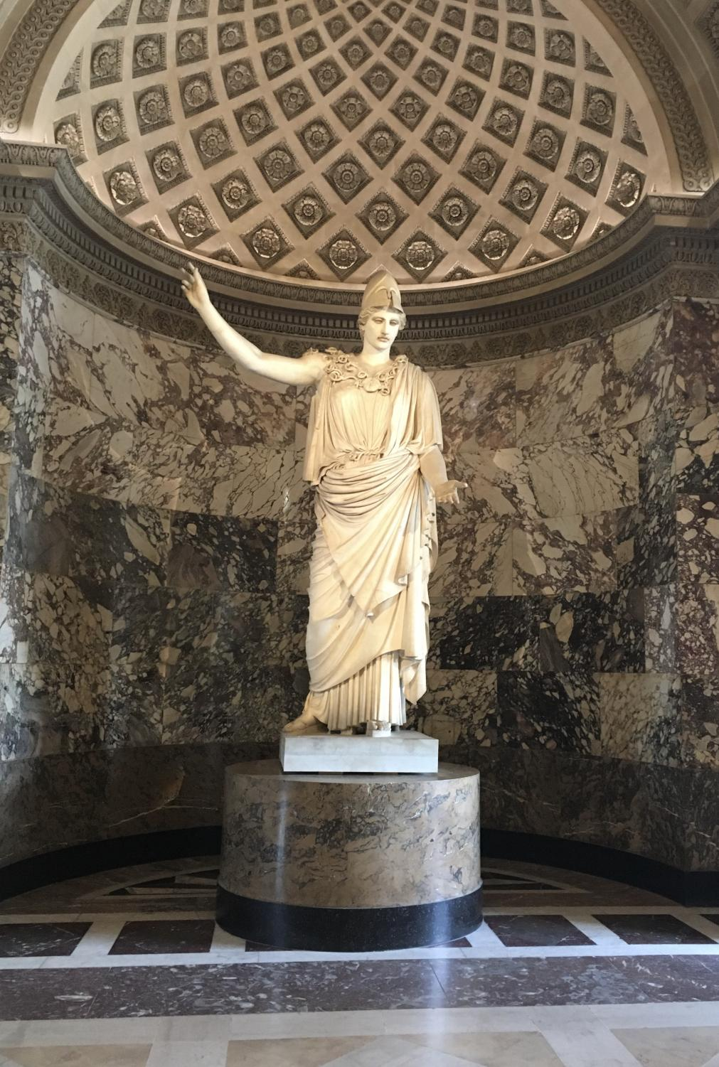 A+sculpture+of+Athena%2C+the+Greek+goddess+of+wisdom%2C+is+set+on+a+pedestal+in+the+Greek+section+of+the+Louvre.+Found+in+Velletri%2C+Rome%2C+this+statue+of+Athena+represents+her+as+a+peaceful+and+strong+leader.