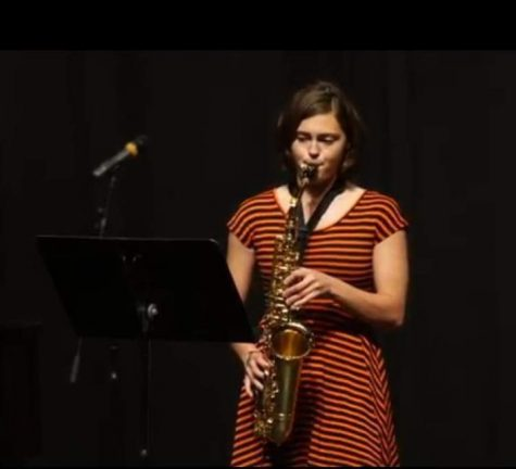 Samantha Simmons plays the saxophone for the last time at Kaneland.