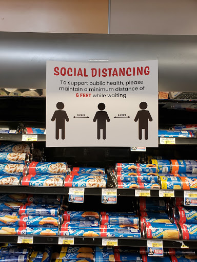 One of the many social distancing papers on display around the store. The posters gave a brief definition of social distancing and a diagram on how to distance properly.