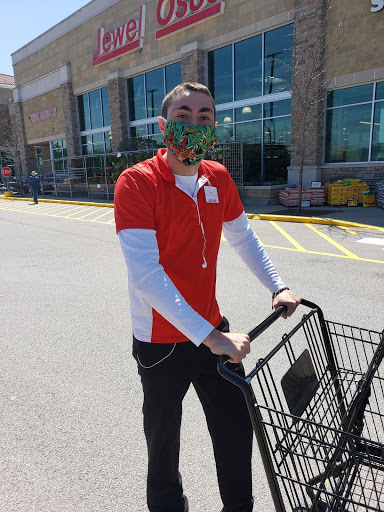 Employee and senior Daniel Occhipinti gave a smile and laugh under the mask as he proceeded to continue his job. Occhipinti had to change the way he performed his job by wearing a mask to slow the spread of COVID-19.