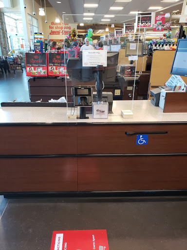 A PlexiGlass barrier stands between customers and employees at Jewel-Osco in Elburn.  PlexiGlass was added as a safety measure because it stops air contamination between the two parties.