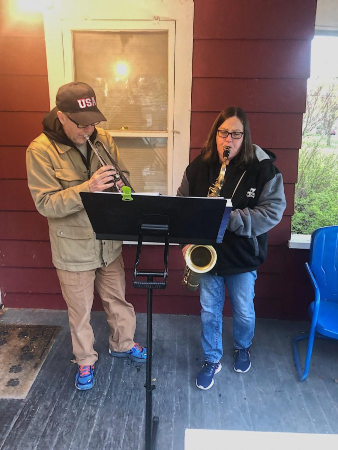 Phil+Hardin+%28left%29+and+Patty+Sampson+%28right%29+play+together+on+Sampson%27s+porch.+They+enjoy+working+together+to+raise+money+for+charity.