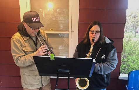 Phil Hardin (left) and Patty Sampson (right) play together on Sampson's porch. They enjoy working together to raise money for charity.