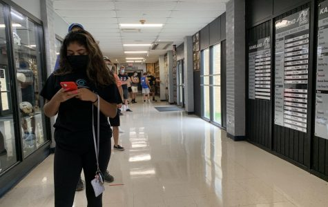 Students wait in line near the main office of Kaneland High School for parking passes. Monday's board meeting focused on updating the details on what is sure to be a different school year for everyone.