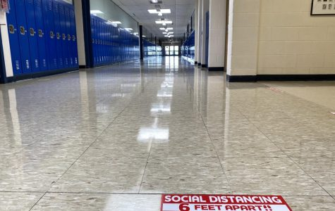 Social distancing signs have been placed throughout Kaneland High School in advance of students' first in-person day of Thursday, August 20. A typically crowded hallway stands empty now, but will look different next week.