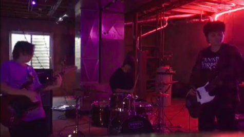 Band members Fiona Garrity (far left), Robbie Green (middle) and Megan Stefanik (far right) practice in Garrity