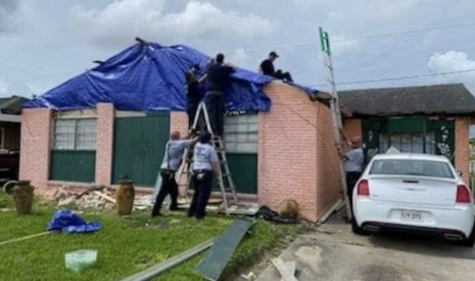 Volunteer firefighters put tarps on roofs in advance of Hurricane Ida's landfall. Kaneland staff member Rebecca Roethecker's husband, Mike, traveled to Louisiana to help residents deal with the damages from the storm.