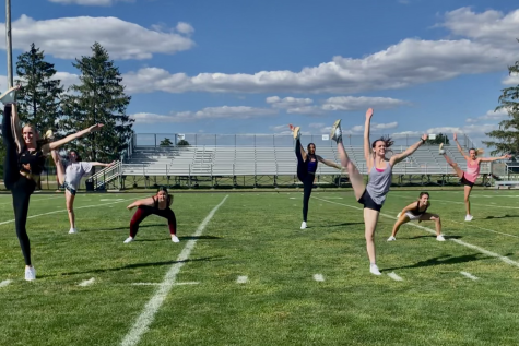 The Kaneland dance team practices on the Peterson Stadium field for an upcoming halftime routine. Each week, the team works to add dances for the next time they perform.